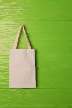 reusable: clothes bag on green background concept for save nature reused bag