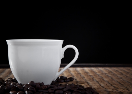 white cup of coffee in studio light photo