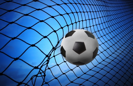 soccer football shoot into goal net  photo