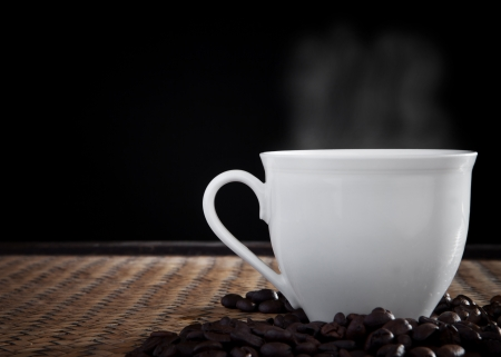 hot coffee with smoke over cup  Stock Photo - 15164713