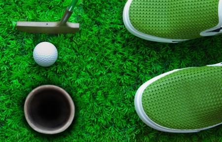 ball point: golf ball on green grass