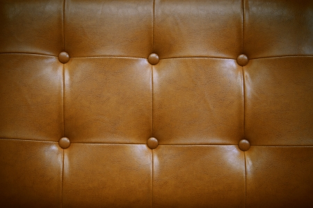 genuine leather: luxury button decorated on brown leather use as high class background