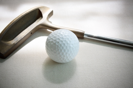 golf ball and putter on white background photo