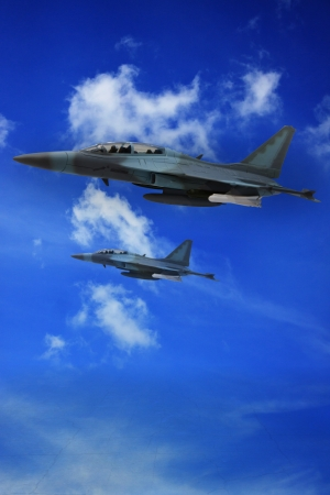 battle plane: milliary air plane flying on blue sky and land ground below Stock Photo