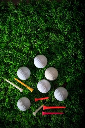golfball: golf ball driver and tee on green grass field