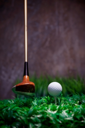 golf driver and golf ball on green grass photo