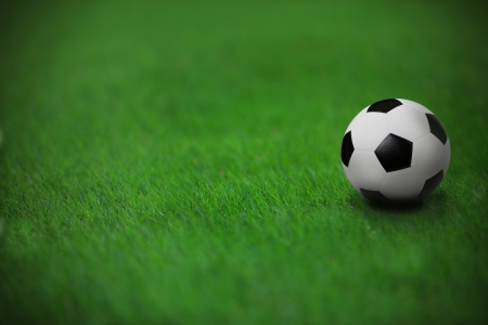 soccer pitch: soccer football on green grass in stadium  with white line