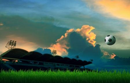 futebol flutuando no ar e estádio fundo com céu colorido