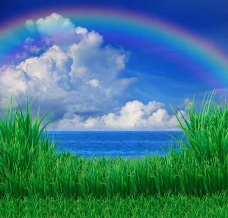 river scape: green grass field and sea sky white cloud rainbow