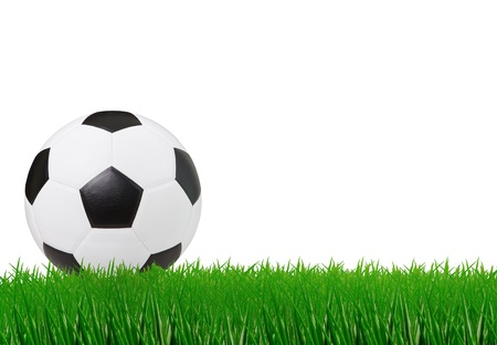 soccer football on green grass and white space background photo