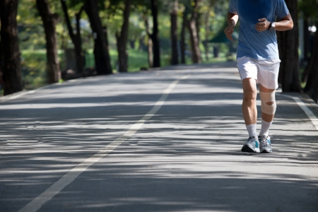 man jogging in the public park photo