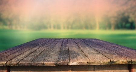wooden beams: texture of old wood table and green park background Stock Photo