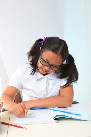 girl happy to do home work Stock Photo - 15961037