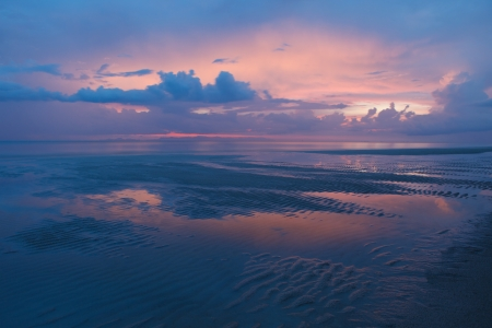 dusky time twilight colorful sky and natural sand beach photo