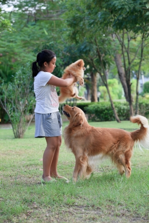 girl playing with her pet in home garden  Stock Photo - 16299448