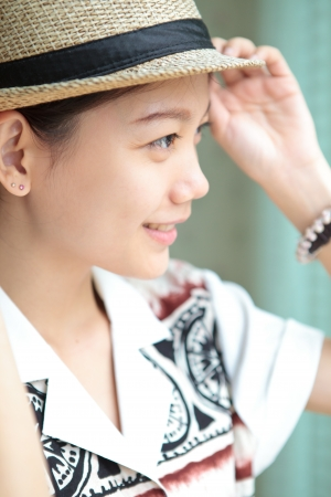 side of asian woman face wearing straw hat Stock Photo - 16491149