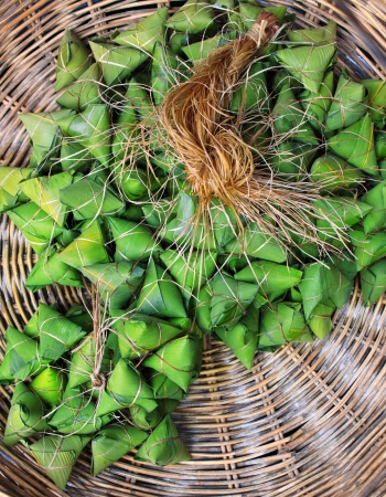 thai dessert packaging by coconut leaves in rattan basket conceptual of nature material photo