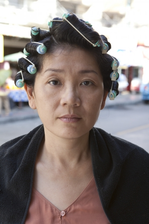 face of asian woman rolling hair curl photo