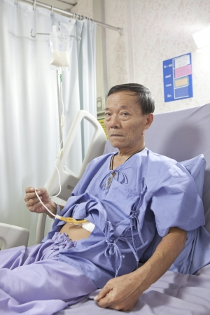 old man patient feeding liquid  food on hospital bed Stock Photo