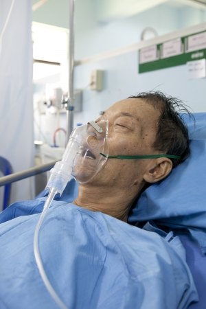o2: old man wearing oxygen mask asleep on patient bed