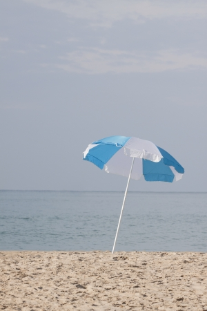 blue and white umbrella and sand beach Stock Photo - 17101867