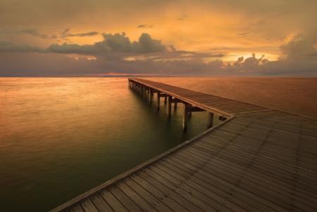 dusky: dusky sky and old wood bridge pier
