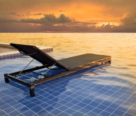 this file made from retouching as pool bed and dusky sky sun set photo