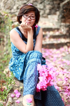 asian woman with pink flower bouquet in her hand smilling to camera Stock Photo - 17564293