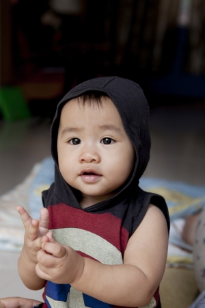 file of face of asian baby sitting in home living room Stock Photo - 17564294