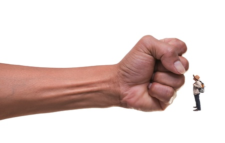 human fist: young man standing infont of punching hand