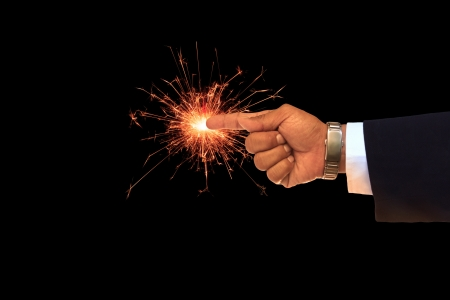 sparking: business man hand pointing on sparking fire