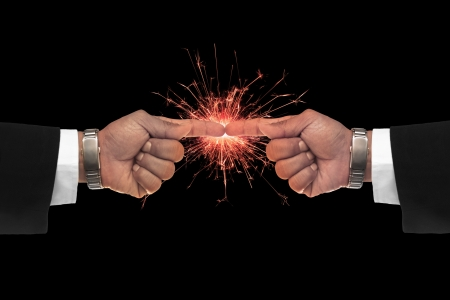 seem: business man hand pointing on sparking fire seem the big deal