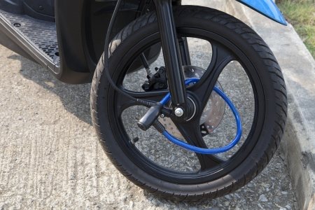 motor bike: portable lock on front wheel motocycle protect from burglary Stock Photo