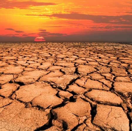 global warming: dry and cracked land from natural disaster scene
