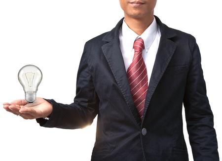 mens en gloeilamp op hand geïsoleerd witte useas slimme man officier creatief goed idee van werkende man Stockfoto