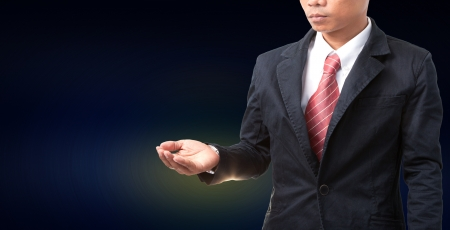 seem: man wearing black suit post seem like holding something in hand use for multipurpose