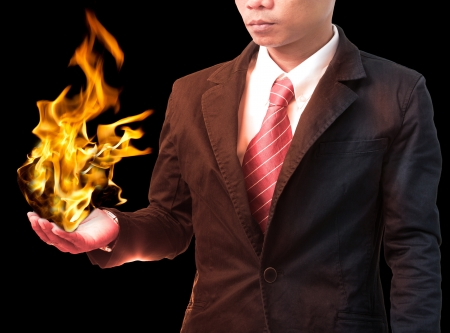 business man holding  fire flaming on hand use for hot topic photo