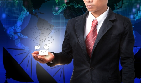 business man holding white envelope of data and information with graphic blue world map photo