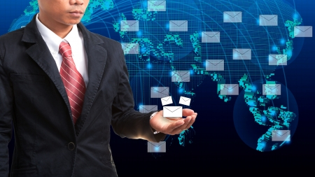 telecoms: business man holding data and information in hand with blue world map Stock Photo