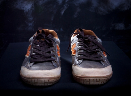 old shoes: sneaker shoes by studio light about footwear theme Stock Photo