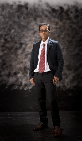 portrait of asian young man standing in business suit photo