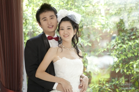 portrait of couples of asian groom and bride in wedding suit photo