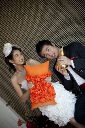 happy face of groom and bride in wedding suit at home use for love theme photo