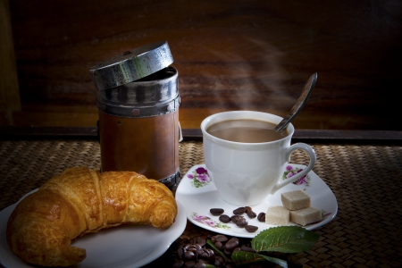 croissant and coffee  morning meal photo