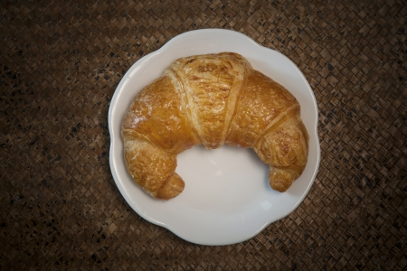 top view of croissant on white plate photo