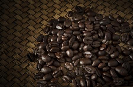 roast coffee bean on wood for coffee theme photo