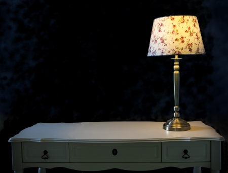light lamp on white table  with dark background photo
