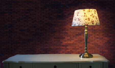big brick wall and light lamp on white table use for multipurpose photo