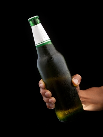 drank: beer bottle in hand  with black background