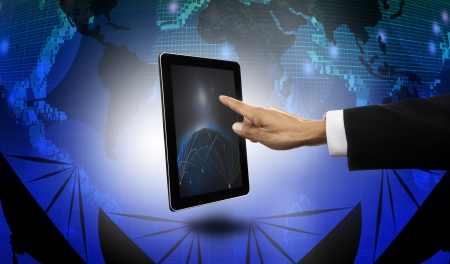 hand of businessman pointing to tablet with satelite dish and world map  background photo